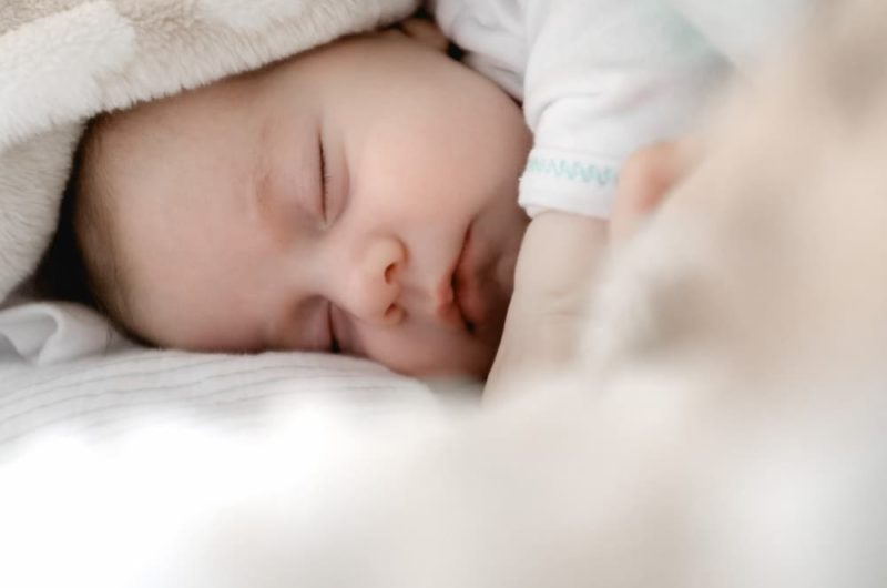 infant baby sleeping covered with blanket